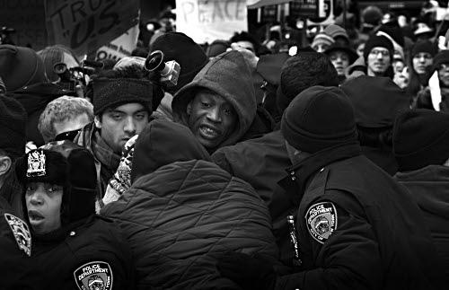 View through police lines, anti-Iraq war demonstration, by Jonathan Sa'adah